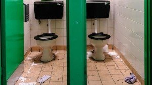 Pair of messy toilets with litter